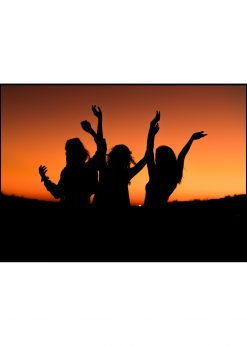 Three Girls In A Beautiful Sunset